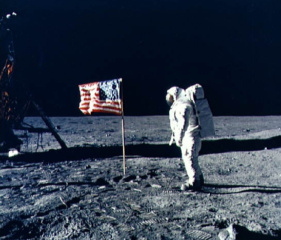 Neil Armstrong walking on the moon during the Apollo 11 mission